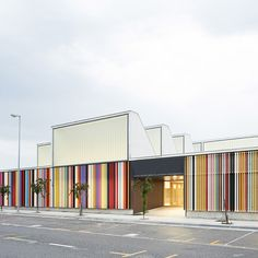 """Berriozar Nursery School"": Colored louvers line the perimeter of this nursery school near Pamplona, Spain. Reminiscent of crayons, the colorful strips provide secure playground areas while letting in filtered light. 