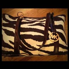 "Authentic MK ZEBRA PRINT The bag is in great condition and is 100% authentic. 14"" W x 9.5"" H x 5"" D Michael Kors Bags"