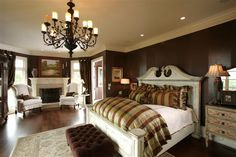 Earthy and elegant master bedroom. Fireplace and chandelier. Neutral browns, gold, black and white. Love this bedroom!!
