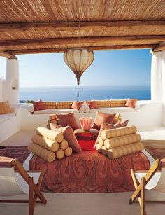 The architect James Cavagnari and his interior designer wife transformed a 300-year-old summer house on the Aeolian island of Salina into a splendid seaside villa with stunning views of the Tyrrhenian sea and the village : http://www.luxinteriordesigns.com/2011/03/designers-home-spectacular.html