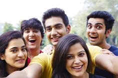 Group of friends taking picture of themselves with a phone and cheering Group Of Friends, Taking Pictures, Cheer, Things To Come, India, Stock Photos, Couple Photos, Phone, Image