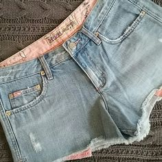 Daisy Dukes Jean shorts in great condition. Pink bandana printed pockets stick out a teeny bit on tbe bottom. *Fits a little smaller.* Mudd Shorts Jean Shorts