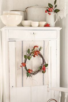 I love the holly sprig in the white pitcher, simple, yet so very pretty...