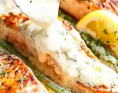 Tender Salmon smothered in a mouthwatering creamy garlic and herb Dijon sauce. Low carb and Keto approved, the sauce alone is addictive to the extreme! Deliciously seasoned, pan fried salmon with crisp edges and flaky Salmon Recipes, Fish Recipes, Seafood Recipes, Dinner Recipes, Cooking Recipes, Healthy Recipes, Keto Recipes, Seafood Dishes, Salmon Dishes