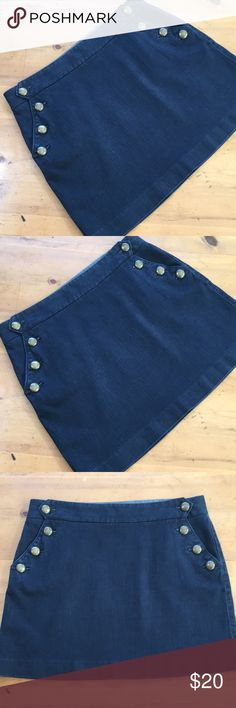 J. Crew Denim Jean Skirt with Brass Hardware Great condition size 10 95% cotton 1% spandex 16 1/2 inches long 16 1/2 inch waist skirt has a button flap with brass buttons to hip pocket stretchy material soft no stains no tears no rips's non-smoking home flat measurements super cute J.Crew💕 J. Crew Skirts