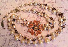 Collier-sautoir-2-rangees-perles-fleur-emaux-strass-marron-orange-metal-bronze