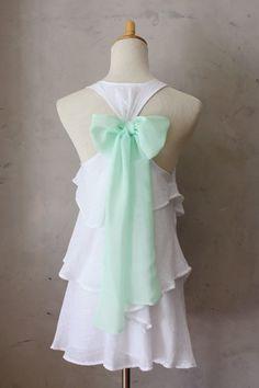 White ruffles, mint bow. Alice