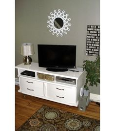Re-Purpose a Dresser by turning it into tv stand. Removing top drawers and add casters.