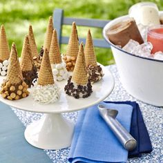 Decorate Ice Cream Cones - just dip in melted chocolate & roll in toppings (I used sprinkles & nuts; lay on cookie sheet & chill; store up to 3 days in container).  Just like the ones at the ice cream parlor! I could use Velata chocolate!!