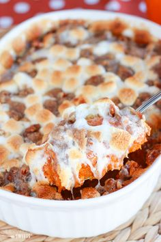Creamy mashed sweet potatoes topped with toasted marshmallows and a brown sugar, cinnamon pecan streusel.