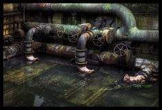 Jorg Dikmann - Decaying pipes of an abandoned steel industry plant at Landschaftspark Duisburg-Nord in Germany's Ruhrgebiet, 28.07.2008