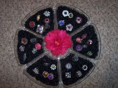 Very creative way to organize your rings. They sure do POP in all that black.
