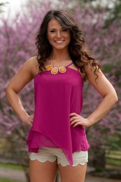 Forget raindrops on roses and whiskers on kittens! Magenta, one shoulder, and fabric that swings- these are a few of our favorite things. This fully lined, asymmetrical tissue tank by Naked Zebra will make the hills come alive and everyone's Von Trapp will fall open when you walk by. Model is wearing a size small.