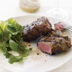 Lamb Chops with Spicy Thai Peanut Sauce | A nutty paste does double duty as a rub and a sauce for these grilled lamb chops from meat master Bruce Aidells.