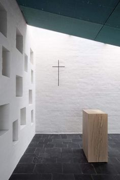 Another view of the interior of the Chapel of St. Lawrence by Avanto Architects/Ville Hara/Anu Puustinen. Light giving live to texture.