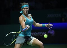 Eugenie Bouchard of Canada returns a ball to Simona Halep of Romania during the Women's Tennis Association (WTA) championships in Singapore on October 20, 2014. (ROSLAN RAHMAN/AFP/Getty Images)