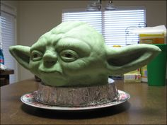 My first sculpted cake, Yoda's head. Ears are rice cereal treats and the rest is cake, all covered in marshmallow fondant.