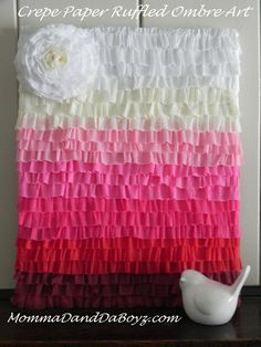 Pin It   Years ago I saw a fabulous tutorial by Stephanie Lynn of Under the Table and Dreaming that showed how to make an inexpensive art piece using nothing more than crepe paper streamers, a sewi