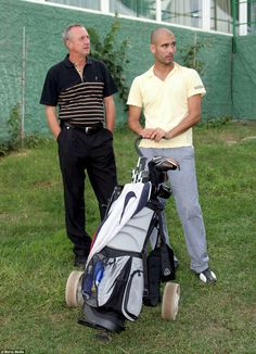 Guardiola enjoys a round of golf with his old Barcelona manager Johan Cruyff in October 2008