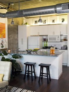 Loft Kitchen- Love the lighting above the cabinets as well as the placement of pictures