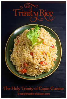 Cajun; Holy Trinity Rice; cuisine; food; recipe; rice; Creole; spicy; peppers; chiles; red; green; celery leaf; celery; onion; yellow; plate; vertical; wood; table; black; warm; still life; dish; pile; cooked; vegetables