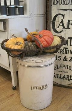 The flour bin and the old wooden sign...the pumpkins are neat too.