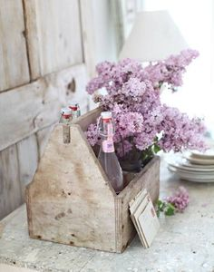 sweet vignette of lilacs in an old toolbox - via http://superblondepuff.blogspot.ro/2014/04/there-something-special-about-lilac.html