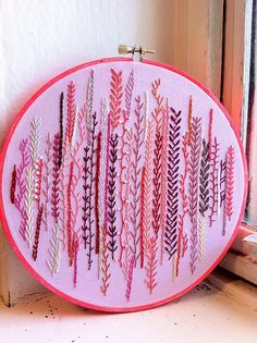 embroidery - pattern reminds me of stalks of grain or algea. Love the colors, too.