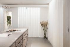 The Danish flooring company Dinesen and cabinetmaker Garde Hvalsøe have opened the doors to a new showroom in the historic landmark buil. Metal Daybed, Showroom Design, Bespoke Kitchens, Ceiling Decor, Bespoke Design, Step Inside, Home Studio, Retail Design, Interior Design Kitchen