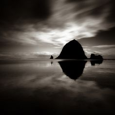 The sea stack Haystack Rock at Cannon Beach, Oregon is 235 feet (72 meters) in height and is accessible by foot at low tide, which you see here.. Nikon, B+W filters. Long Exposure. In Nature, Scenery, Waterscape. Calculi Magnified, photography by Michael Salmela. Image #445632