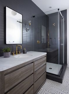 Sleek modern dark bathroom with glossy tiled walls | Threshold Interiors NYC