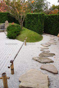 Beautiful use of irregular pavers and green berm.