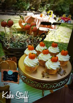 Pumpkin cupcakes at a pumpkin baby shower party! See more party ideas at CatchMyParty.com!