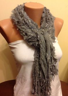 Hey, I found this really awesome Etsy listing at https://www.etsy.com/listing/180040560/grey-knitted-scarffringed-scarf-knitted