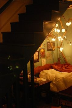 cozy light / corner bed. one of my kids is bound to want an area for themselves like this for their homework, thoughts, or relaxation.