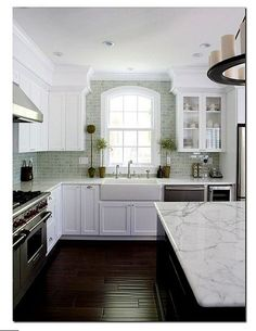 dark hardwoods with white cabinets and blue back splash.