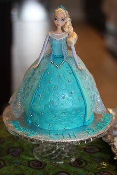 Frozen Elsa cake with fondant - I used the Wilton classic wonder mold and made an extra round cake for height.  This recipe will fill both cake pans http://www.todaysparent.com/recipe/dessert/vanilla-birthday-cake-with-buttercream-icing/