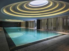 The ceiling of this indoor swimming pool took its design inspiration from the terraced rice fields in China. Located at the Temple House hotel in Chengdu, China. x -- OPENPICS. Home Temple, Temple House, Urban Day Spa, Piscina Interior, Spa Lighting, Hotel Restaurant, Wallpaper Magazine, Indoor Swimming Pools, Chengdu