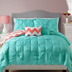 Bring together teal and coral to decorate a bedroom. Teal is a hue that combines blue and green, both considered perfect colours for a soothing and serene bedroom. With a few coral accents you have a bedroom that is cool and calm and perfect for any season.