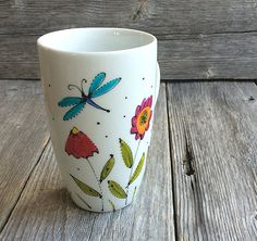 Coffee or tea mug, coffee Cup Porcelain flowers and dragonfly Hand painted by artist Isabelle Malo Blue Pottery, Ceramic Pottery, Pottery Painting, Ceramic Painting, Dragonfly Wall Art, Painted Coffee Mugs, Sharpie Crafts, Crafts For Seniors, Painted Wine Glasses