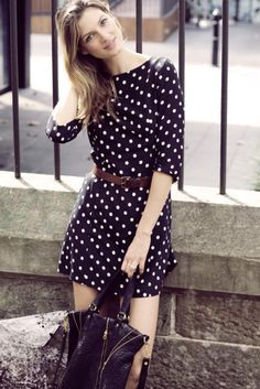 i love polka dots a fluff but then they added a leather belt to toughen it up and it balances the look perfectly.