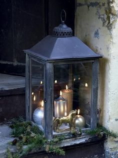Christmas Wedding - red n silver candles tho. Candles of different shapes and sizes set in a big lantern. Silver and gold add a glamorous note to the rustic lantern. Rustic Lanterns, Lanterns Decor, Candle Lanterns, Hurricane Lanterns, Hanging Lanterns, Silver Christmas, Noel Christmas, Christmas Crafts, Xmas