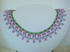 "This pattern is available in the ""Drop Lace Necklace Pattern"" eBook and is Made by Nola Dorren-Rideout"