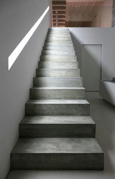 Light window as banister on concrete stairs. House in Ontiyent by Borja Garcia Studio.