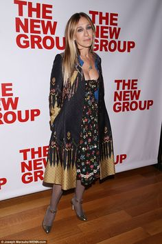 Gorgeous: SJP made sure to show off her impressive cleavage in a low necked floral dress, making sure she was the center of attention in the fashion stakes