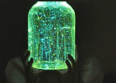 Universe in a mason jar: fun craft: empty jar and glow in the dark craft paint.