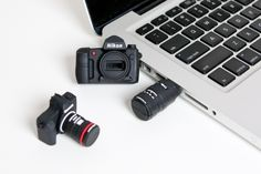 Camera USB Drive, a miniature, finely detailed replica of a DSLR with the powerful file-holding ability of 4GB. $20.00
