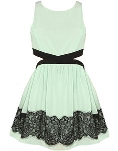 Mint Metropolis Dress Features Fashion-Forward Side Cutouts Surrounded by Bold Black Lines & Twirly Skirt