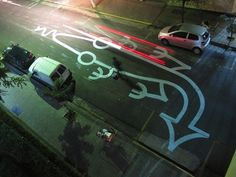 A Street Artist In Brazil Who Draws Large, Whimsical Cartoon Drawings On Roads - DesignTAXI.com