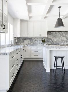 In another coup de force by DISC Interiors, this monochrome kitchen is the perfect mix of modern and traditional. The thick marble slabs and neutral palette give the space a modern edge while...